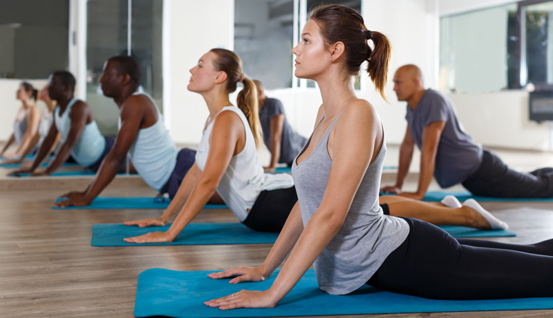 women exercising during yoga class