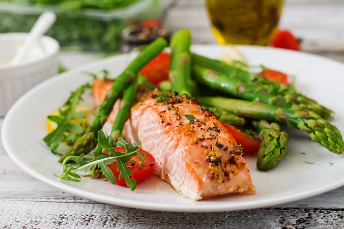 Baked salmon garnished with asparagus